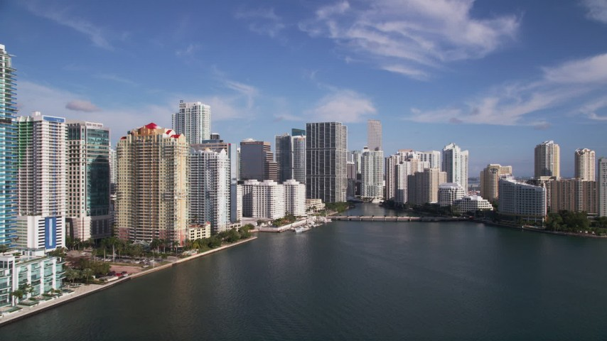 5K aerial video fly low over Biscayne Bay, reveal skyscrapers and Brickell Key, Downtown Miami, Florida Aerial Stock Footage | AX0024_054
