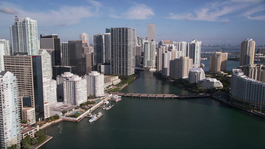 5K stock footage aerial video of approaching Brickell Key Drive bridge, Downtown Miami, Florida Aerial Stock Footage | AX0024_055