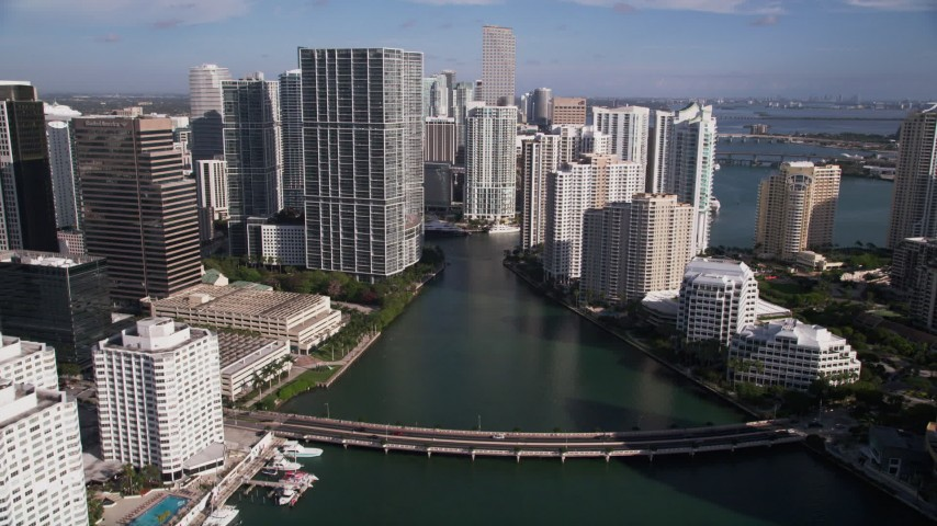 5K stock footage aerial video fly over Brickell Key Drive bridge, approach Miami River, Downtown Miami, Florida Aerial Stock Footage | AX0024_056