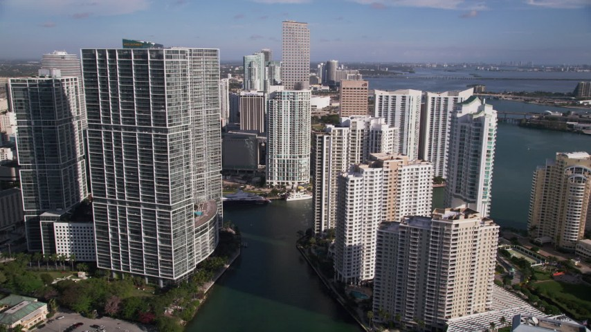 5K stock footage aerial video fly between skyscrapers and Brickell Key to Southeast Financial Center, Downtown Miami, Florida Aerial Stock Footage | AX0024_057