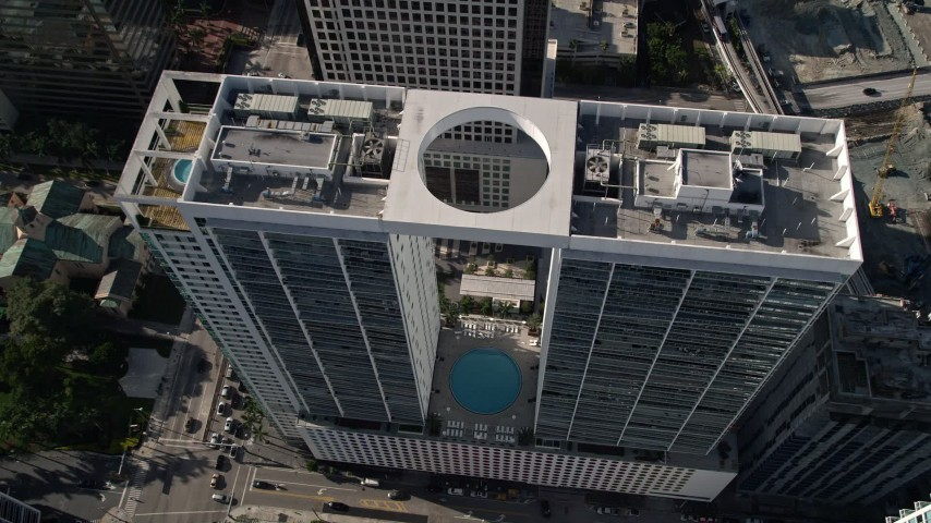 5K stock footage aerial video approach 500 Brickell West Tower, tilt to bird's eye view, Downtown Miami, Florida Aerial Stock Footage | AX0024_059