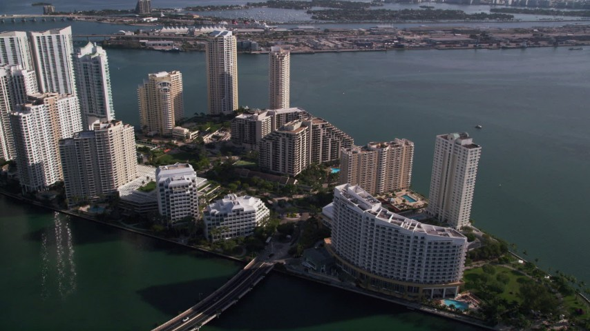 5K stock footage aerial video fly over Mandarin Oriental to Brickell Key condos, Downtown Miami, Florida Aerial Stock Footage | AX0024_061