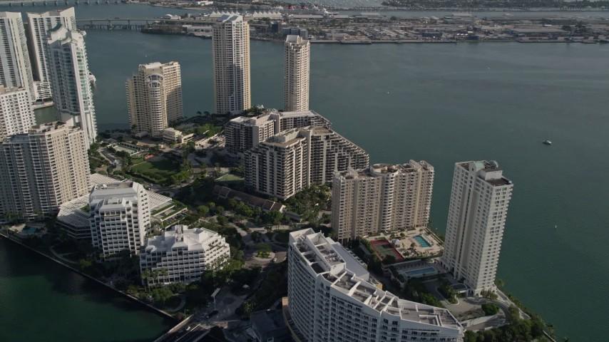 5K stock footage aerial video fly over Mandarin Oriental to Brickell Key condos, Downtown Miami, Florida Aerial Stock Footage | AX0024_061E