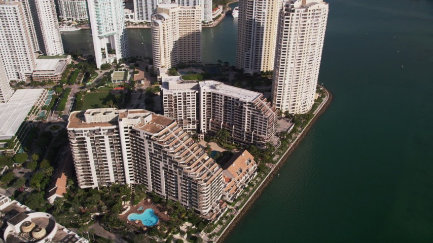 5K aerial video of orbiting condo complexes on Brickell Key, Downtown Miami, Florida Aerial Stock Footage | AX0024_062