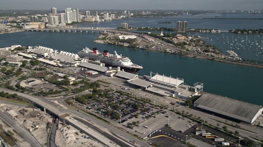 5K stock footage aerial video approach and flyby Disney cruise ship docked at Port of Miami, Miami, Florida Aerial Stock Footage | AX0024_063