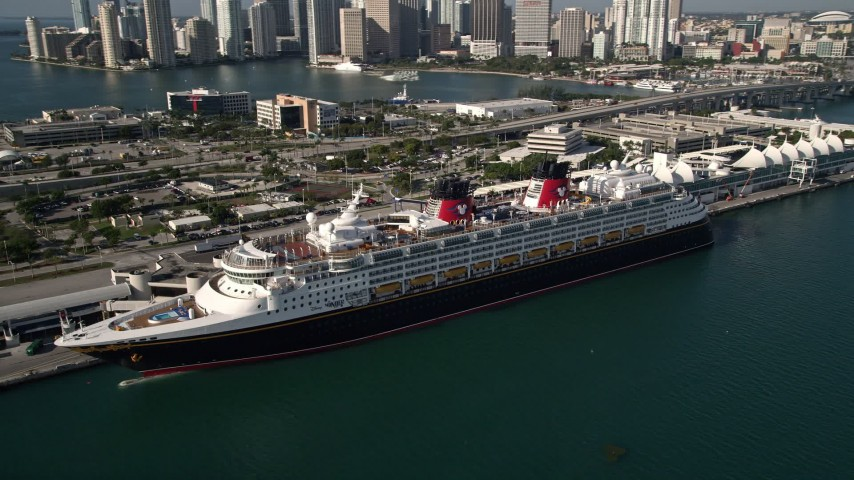 5K stock footage aerial video of orbiting Disney Cruise Ship docked at Port of Miami, Miami, Florida Aerial Stock Footage | AX0024_064