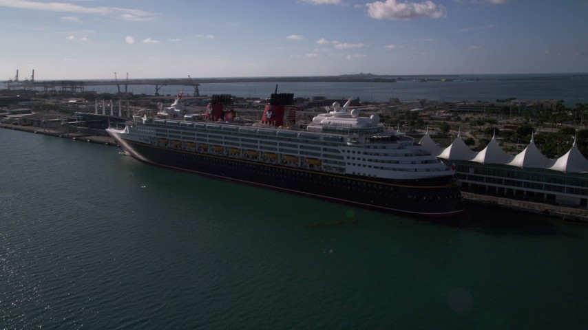 5K stock footage aerial video of approaching and flying by Disney Cruise Ship at Port of Miami, Miami, Florida Aerial Stock Footage | AX0024_066
