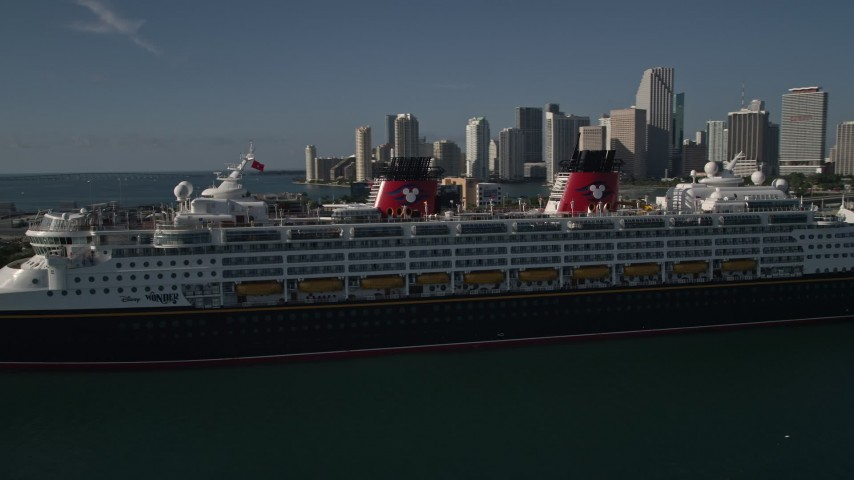 5K stock footage aerial video of approaching and flying by Disney Cruise Ship at Port of Miami, Miami, Florida Aerial Stock Footage | AX0024_066E