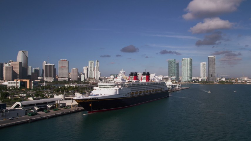 5K stock footage aerial video of orbiting  Disney Cruise Ship docked, Port of Miami, view of skyline, Miami, Florida Aerial Stock Footage | AX0024_067