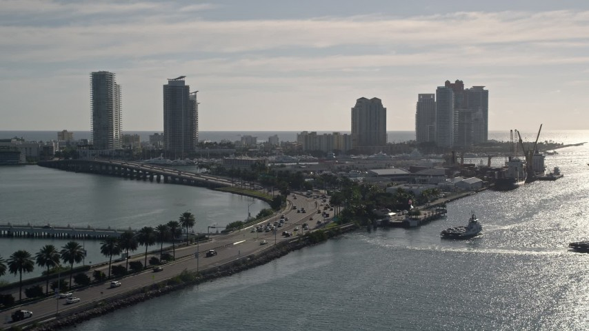 5K stock footage aerial video of following MacArthur Causeway, South Beach, Miami Beach, Florida Aerial Stock Footage | AX0024_069
