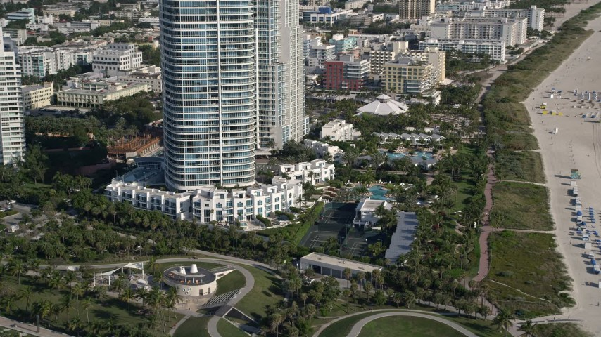 5K stock footage aerial video of flying by South Pointe Park, South Beach, Miami Beach, Florida Aerial Stock Footage | AX0024_076