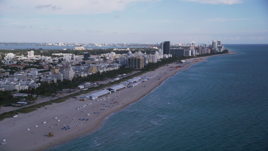 Flying over the beach, approaching South Beach hotels, Miami Beach, Florida Aerial Stock Footage | AX0024_078