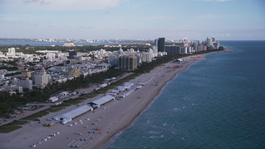 5K aerial video of flying over the beach, approaching South Beach hotels, Miami Beach, Florida Aerial Stock Footage | AX0024_078
