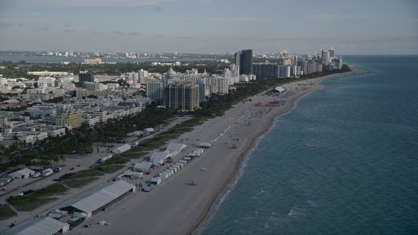 5K stock footage aerial video of flying over the beach, approaching South Beach hotels, Miami Beach, Florida Aerial Stock Footage   AX0024_078E
