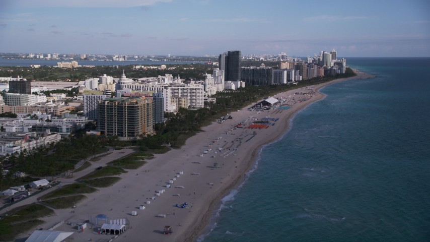 Flying over the beach and past South Beach hotels, Miami Beach, Florida Aerial Stock Footage | AX0024_079