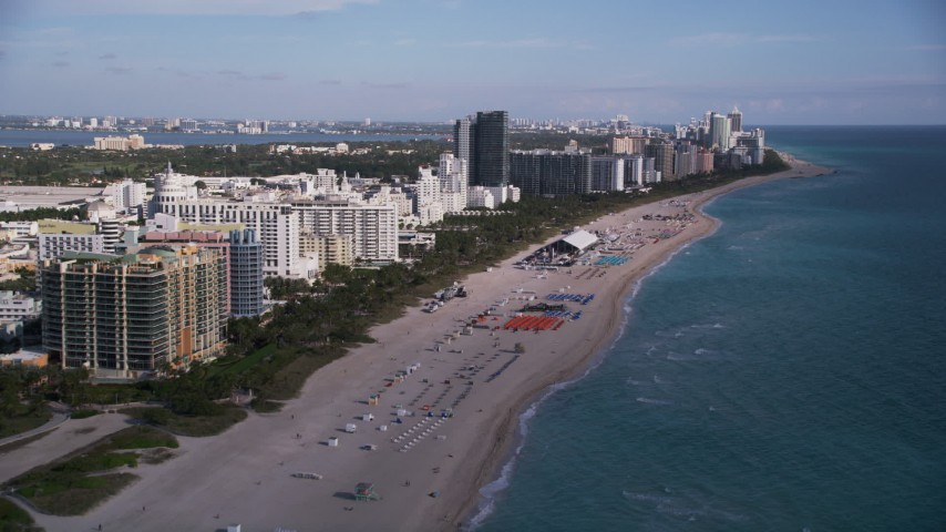 5K aerial video of flying over the beach and past South Beach hotels, Miami Beach, Florida Aerial Stock Footage | AX0024_079