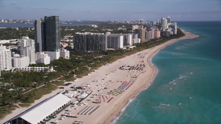 5K stock footage aerial video of flying over the beach and past South Beach hotels, Miami Beach, Florida Aerial Stock Footage | AX0024_080