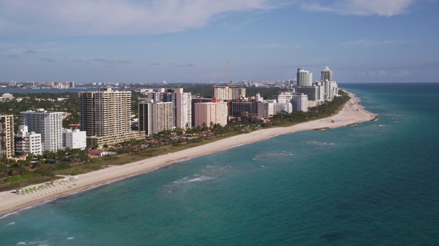 5K stock footage aerial video of flying by apartment buildings along the shore, South Beach, Miami Beach, Florida Aerial Stock Footage | AX0024_081