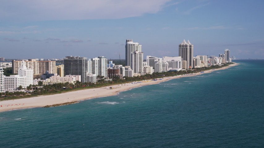 5K stock footage aerial video of flying by hotels along the shore, Miami Beach, Florida Aerial Stock Footage | AX0024_082