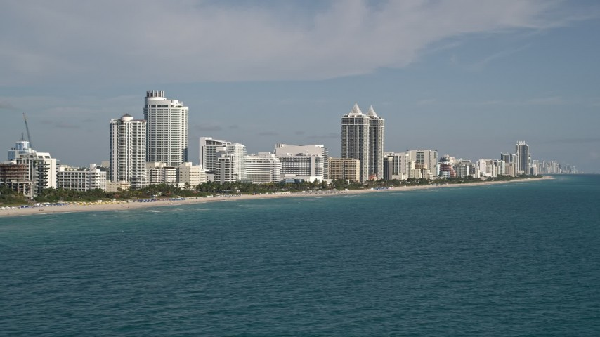 5K stock footage aerial video of flying by hotels along the shore, Miami Beach, Florida Aerial Stock Footage | AX0024_082E