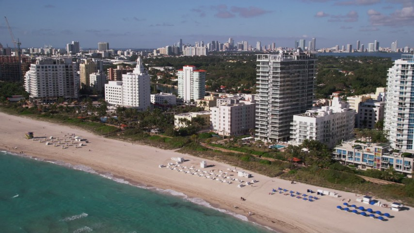 5K stock footage aerial video of flying by hotels and condo complexes, Miami Beach, Florida Aerial Stock Footage | AX0024_090