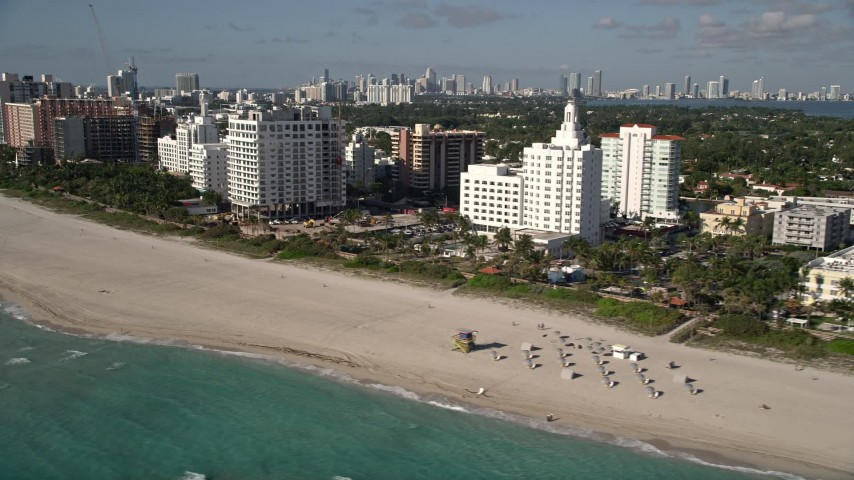 5K stock footage aerial video of flying by hotels and condo complexes, Miami Beach, Florida Aerial Stock Footage   AX0024_090E