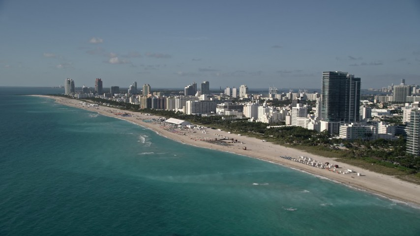 5K aerial video of flying by hotels by the beach, South Beach, Miami Beach, Florida Aerial Stock Footage | AX0024_092