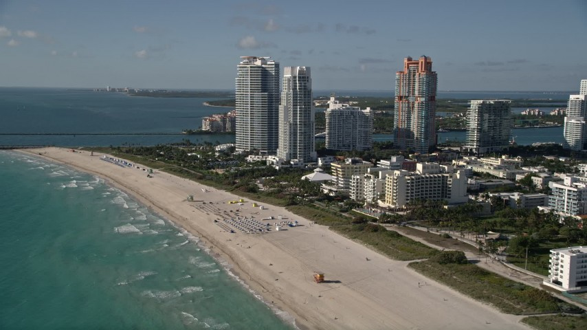 5K stock footage aerial video of flying by the beach, approaching skyscrapers, South Beach, Miami Beach, Florida Aerial Stock Footage | AX0024_096