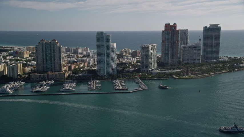 5K stock footage aerial video of approaching Miami Beach Marina, skyscrapers in South Beach, Miami Beach, Florida Aerial Stock Footage | AX0024_102