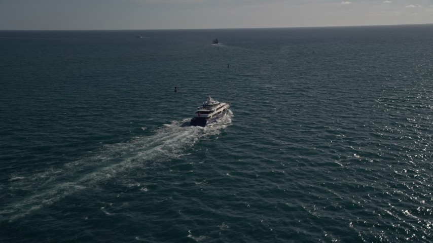 5K stock footage aerial video of tracking a yacht, Atlantic Ocean, Miami, Florida Aerial Stock Footage | AX0024_104