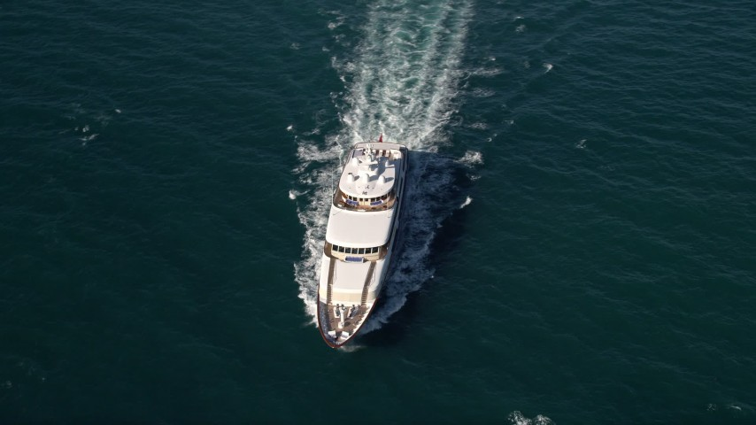 5K stock footage aerial video of tracking a yacht, Atlantic Ocean, Miami, Florida Aerial Stock Footage | AX0024_107E