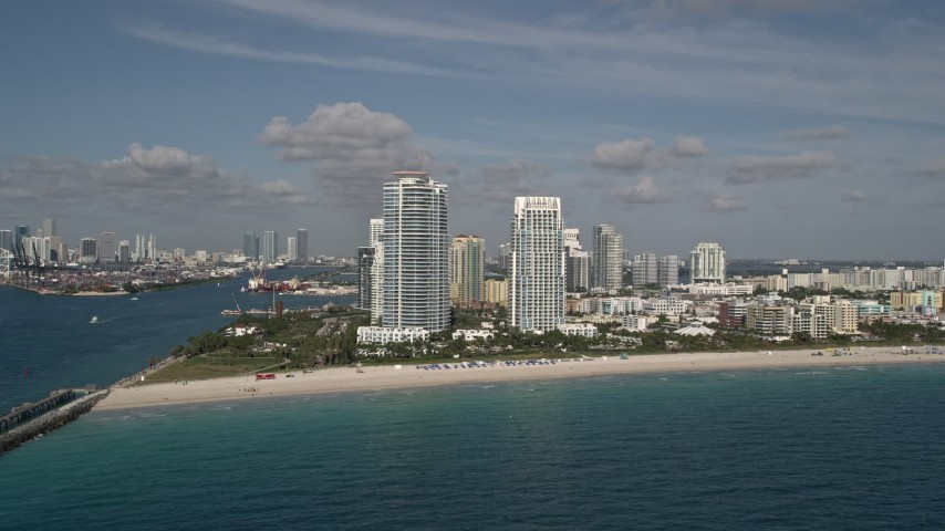5K stock footage aerial video of flying over Atlantic Ocean, reveal South Beach skyscrapers, Miami Beach, Florida Aerial Stock Footage | AX0024_112