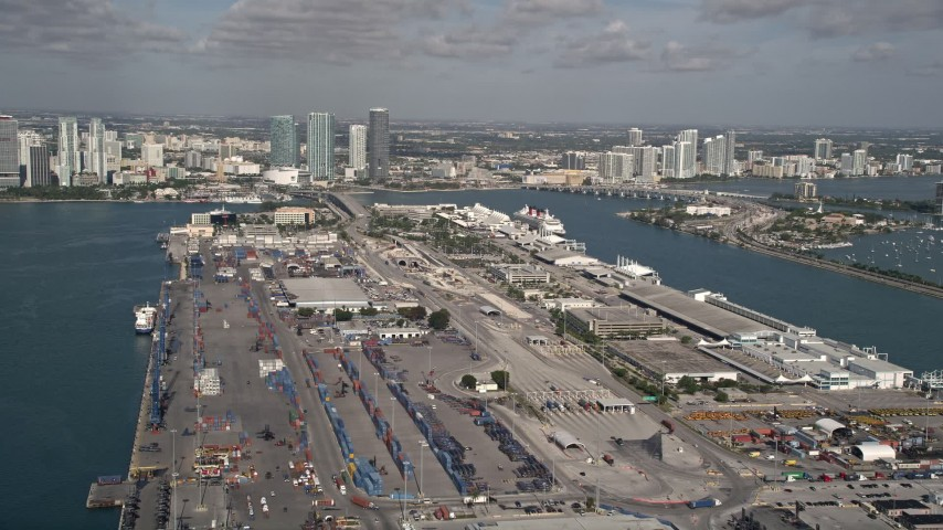 5K stock footage aerial video of flying by Port of Miami and a Disney cruise ship, Miami, Florida Aerial Stock Footage | AX0024_117