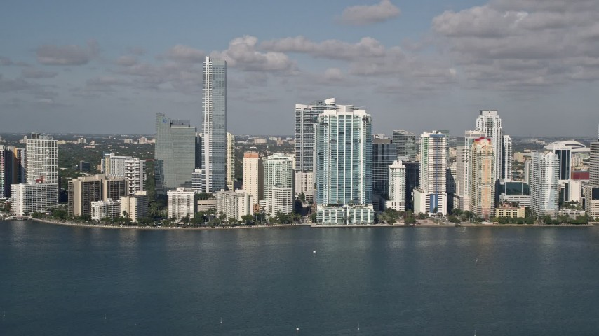 5K stock footage aerial video of flying by Downtown Miami skyline, seen from Biscayne Bay, Florida Aerial Stock Footage | AX0024_119