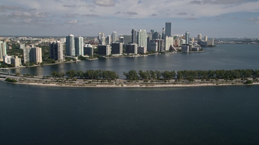 5K stock footage aerial video of flying by Downtown Miami skyline, Rickenbacker Causeway, Florida Aerial Stock Footage | AX0024_127