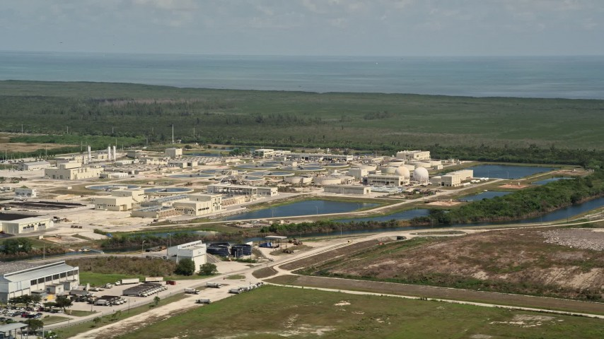 5K stock footage aerial video of flying by the  South District Wastewater Treatment Plant, Homestead, Florida Aerial Stock Footage | AX0025_010