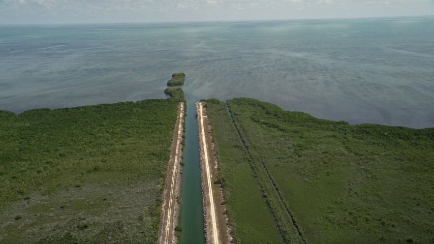 5K stock footage aerial video of orbiting canal to Atlantic Ocean in Mangrove Preserve, Homestead, Florida Aerial Stock Footage | AX0025_012
