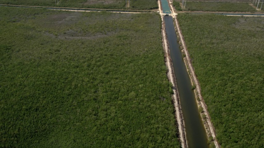 5K stock footage aerial video flyby canal, reveal length of canal and Mangrove Preserve, Homestead, Florida Aerial Stock Footage | AX0025_016