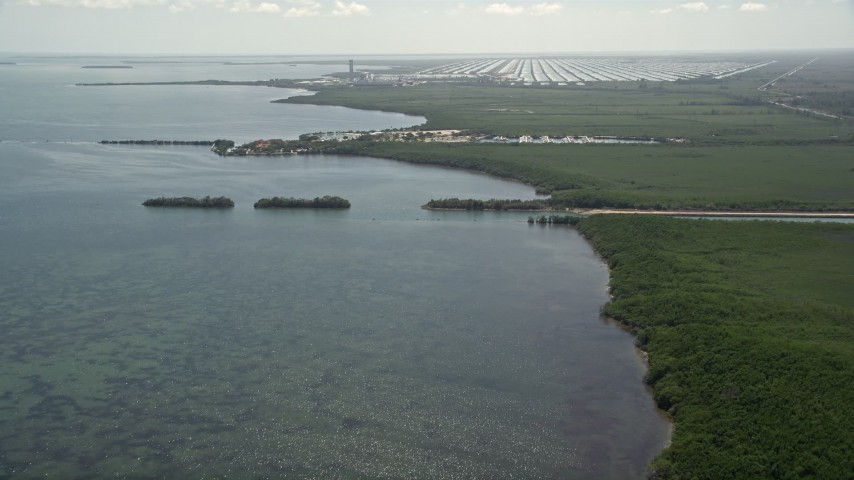 5K stock footage aerial video of Mangrove Preserve, Homestead Bayfront Park, Turkey Point Power Plant, Homestead, Florida Aerial Stock Footage AX0025_017 | Axiom Images