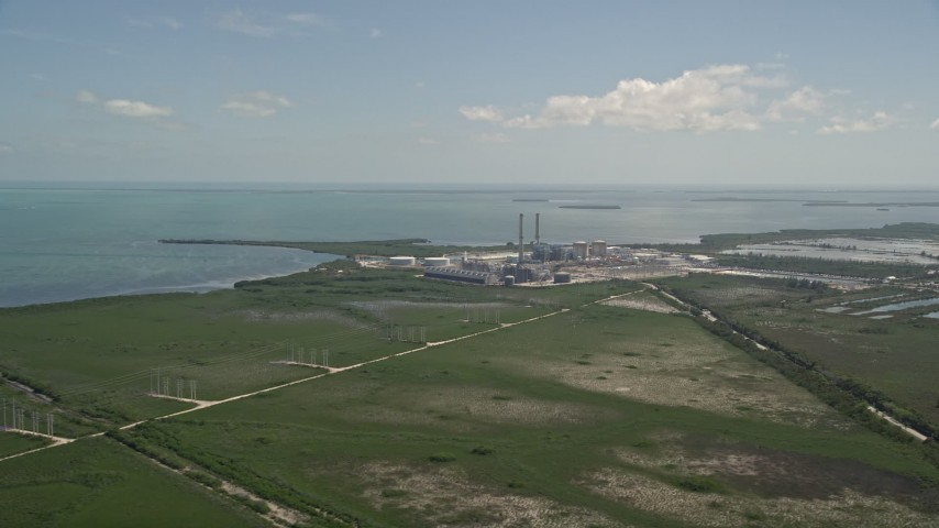 5K stock footage aerial video of flying by power lines, revealing Turkey Point Power Plant, Homestead, Florida Aerial Stock Footage | AX0025_020
