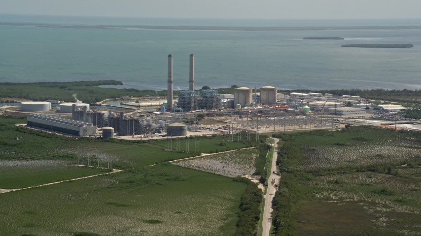 5K stock footage aerial video of flying by Turkey Point Power Plant, Homestead, Florida Aerial Stock Footage | AX0025_021