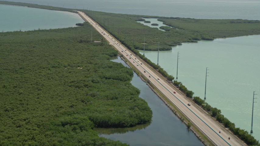 5K stock footage aerial video of tracking light traffic on Overseas Highway, Key Largo, Florida Aerial Stock Footage | AX0025_046E