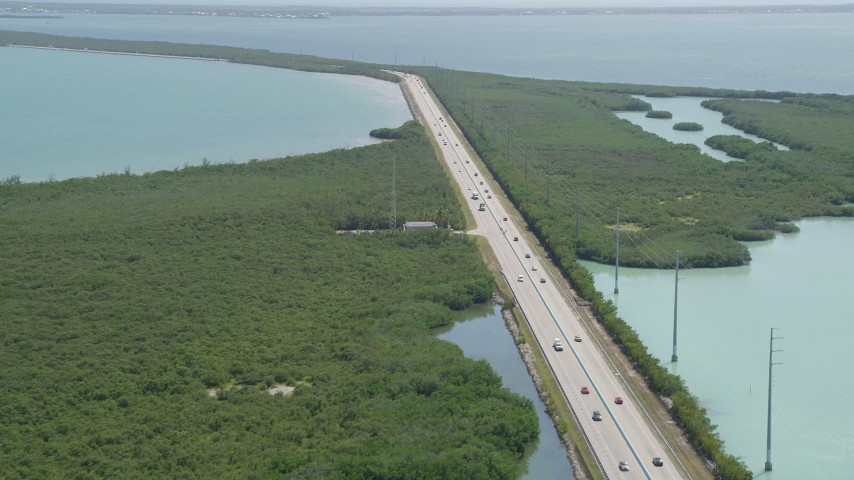 5K stock footage aerial video of tracking light traffic on Overseas Highway, Key Largo, Florida Aerial Stock Footage | AX0025_047