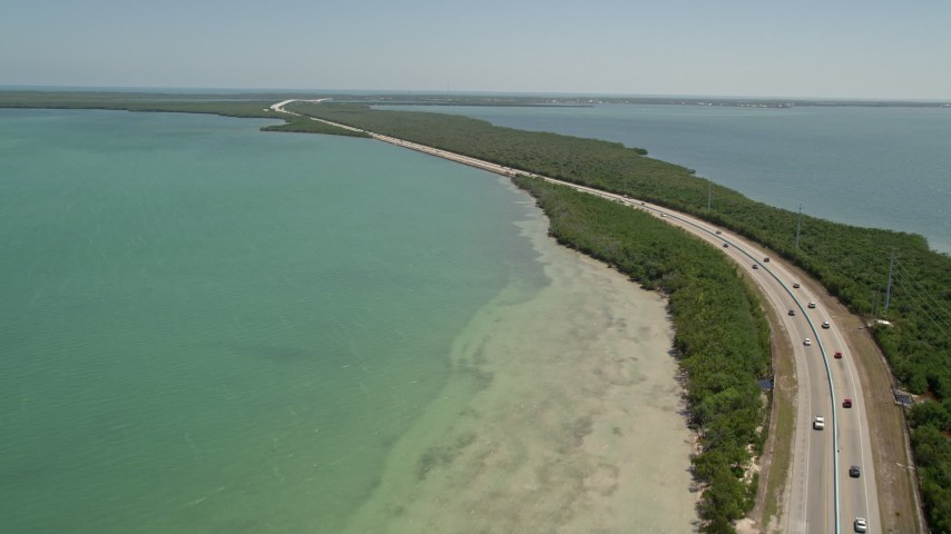 5K stock footage aerial video of following light traffic on Overseas Highway, Key Largo, Florida Aerial Stock Footage | AX0025_049