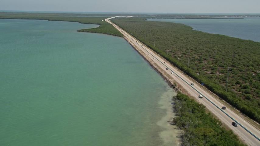 5K stock footage aerial video of light traffic on Overseas Highway, Key Largo, Florida Aerial Stock Footage | AX0025_050