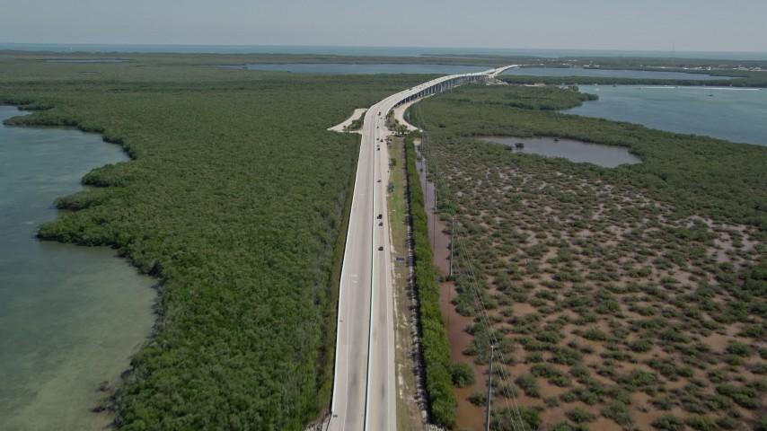 5K stock footage aerial video follow traffic on Overseas Highway, Key Largo, Florida Aerial Stock Footage | AX0025_051