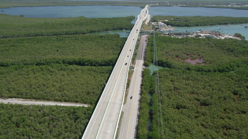 5K stock footage aerial video of Overseas Highway, the Anchorage Resort and Yacht Club,  and Gilbert's Resort, Key Largo, Florida Aerial Stock Footage | AX0025_052