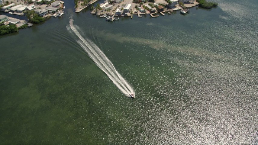 5K stock footage aerial video of homes on Lake Surprise, track speedboat on Sexton Cove, Key Largo, Florida Aerial Stock Footage | AX0025_057