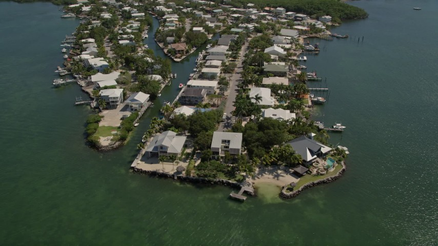 5K stock footage aerial video of approaching homes on shore of Sexton Cove, Key Largo, Florida Aerial Stock Footage | AX0025_058