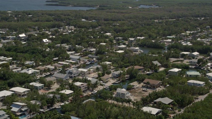 5K stock footage aerial video of flying by homes on canals, Key Largo, Florida Aerial Stock Footage | AX0025_062